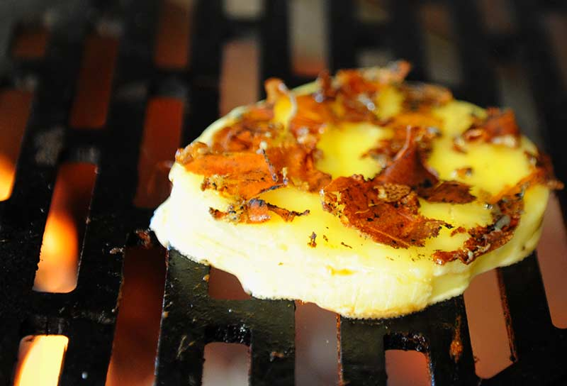 Provolone grilling on the Kalamazoo Aregentinian Gaucho Grill