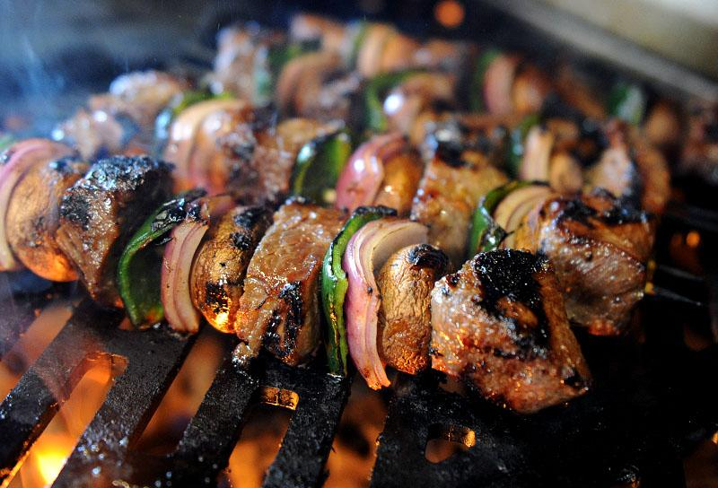 Ginger Bourbon Beef Kebabs gilling on the Hybrid Fire Grill