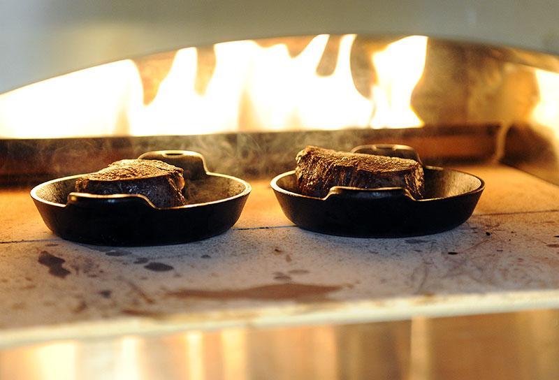 Tenderloin steaks roasting in the pizza oven