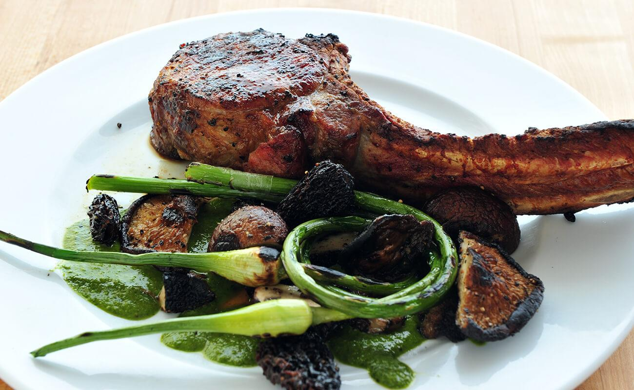 Image of Tomahawk Chops with Grilled Mushrooms and Garlic Scapes