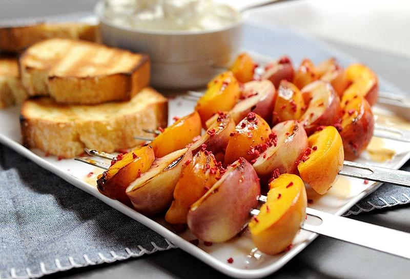 Image of Grilled Fruit Kebabs with Maple Glaze and Bourbon-spiked Whipped Cream
