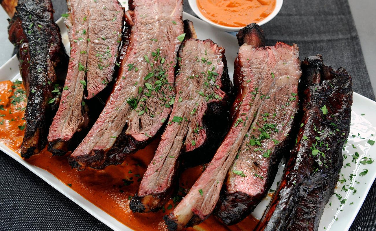 Image of Smoked Beef Ribs with Roasted Tomato Harissa