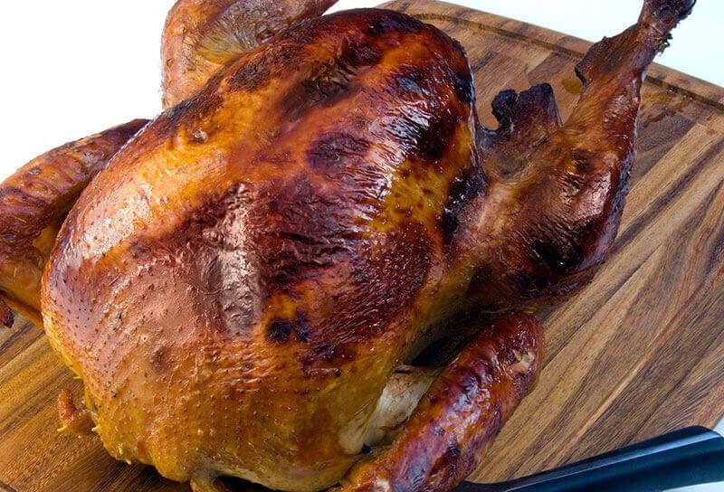 Image of Rick Bayless's Brined Turkey with Red Chile Adobo Sauce and Jícama-Cranberry Relish