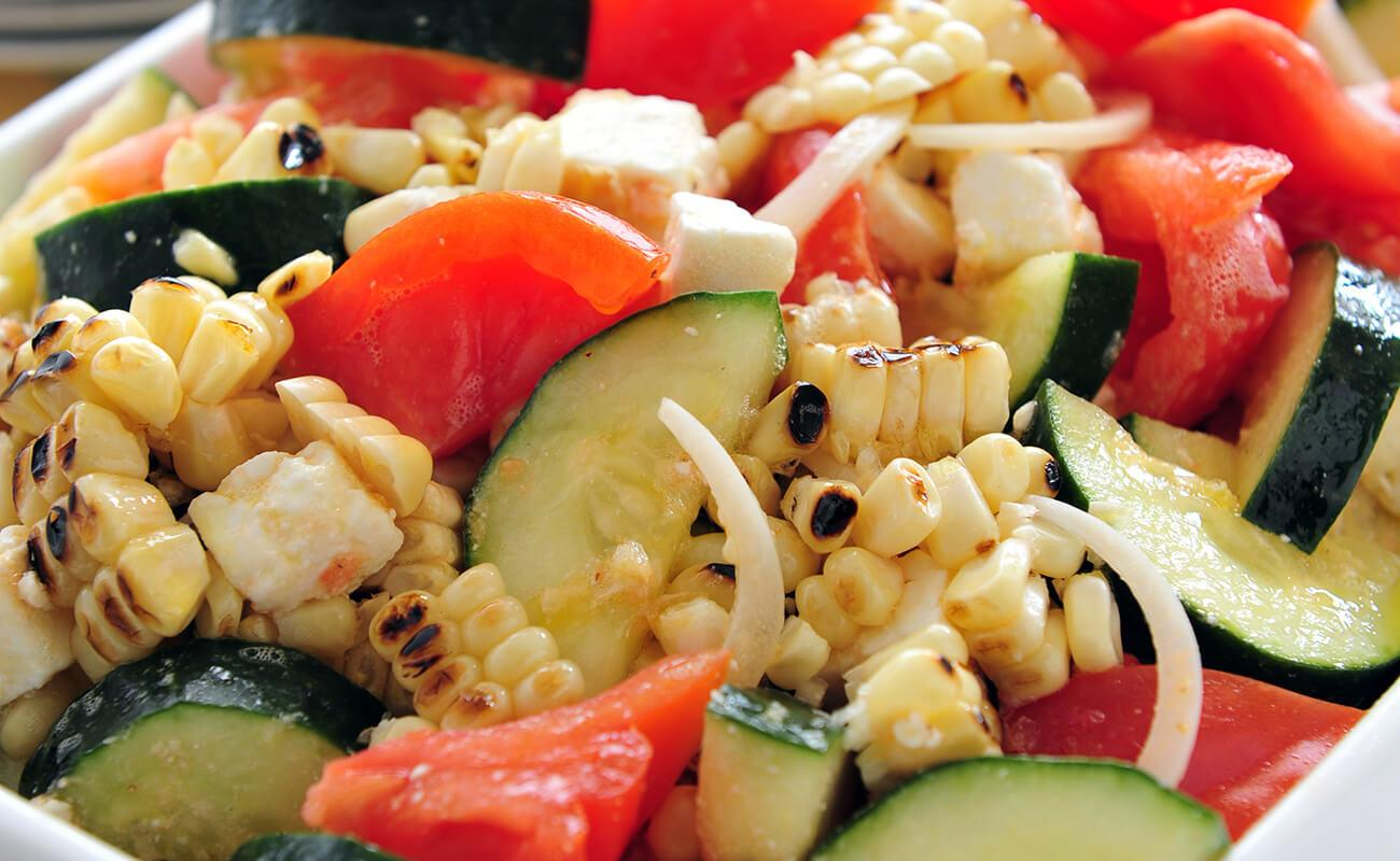 Image of Tomato and Cucumber Summer Salad with Grilled Corn